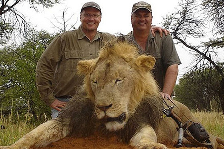 Walter J. Palmer (left) with one of his trophies. (man at right is unidentified) photo: facebook.